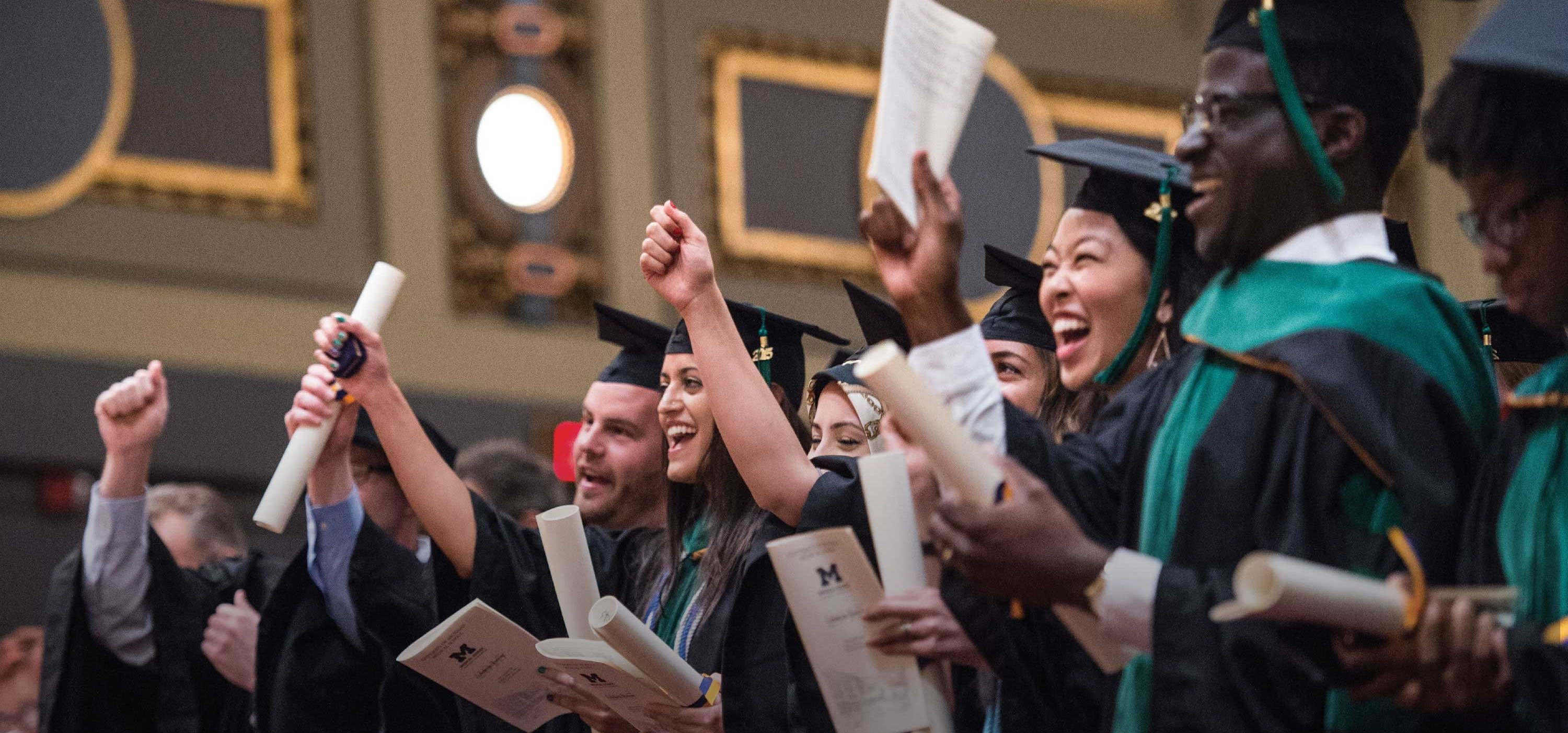 "University of Michigan Medical School students sing ""The Victors"" during a recent commencement ceremony."