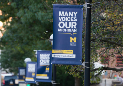 A banner promoting diversity, equity and inclusion hangs on U-M's campus. (Michigan Photography)